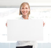 Beautiful woman holding empty white board Stock Images