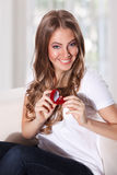 Beautiful woman holding an engagament ring Stock Photos