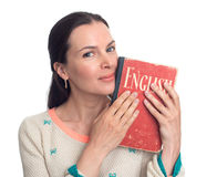 Beautiful woman holding an English textbook. Isolated on white background Royalty Free Stock Photos