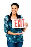 Beautiful woman holding exit sign Royalty Free Stock Photos
