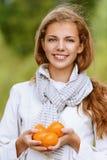 Beautiful woman holding few juicy Royalty Free Stock Image