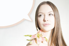 Beautiful woman holding flower on white copyspace background and bubble Royalty Free Stock Images