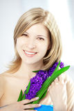 Beautiful woman with holding flowers Stock Images