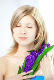 Beautiful woman with holding flowers Royalty Free Stock Photo