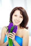 Beautiful woman with holding flowers Stock Image