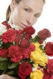 Beautiful woman holding a flowers bouquet Royalty Free Stock Images