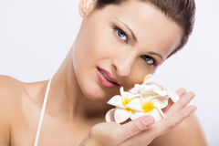 Beautiful woman holding flowers Royalty Free Stock Images