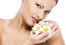 Beautiful woman holding flowers Stock Photography