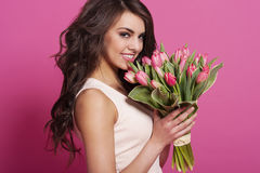 Beautiful woman holding flowers stock images