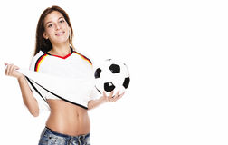 Beautiful woman holding football pulling her footb Royalty Free Stock Photo
