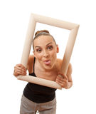 Beautiful woman holding a frame and smiling Stock Photos