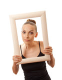 Beautiful woman holding a frame and smiling Stock Photography