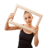 Beautiful woman holding a frame and smiling Stock Image