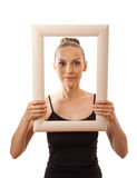 Beautiful woman holding a frame and smiling Royalty Free Stock Photography