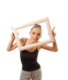 Beautiful woman holding a frame and smiling Royalty Free Stock Photo