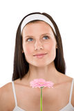 Beautiful woman holding gerbera daisy flower Royalty Free Stock Images