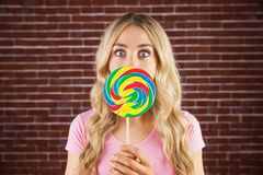 A beautiful woman holding a giant lollipop Royalty Free Stock Photos