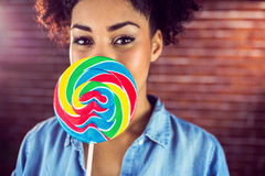 A beautiful woman holding a giant lollipop stock photography
