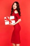 Beautiful woman holding gift box with blue ribbon Royalty Free Stock Photo