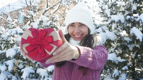 Beautiful woman holding a gift box in the form of heart.  stock video