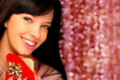 Beautiful woman holding a gift Royalty Free Stock Photos