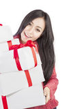 Beautiful woman holding gifts isolated in white Royalty Free Stock Photography