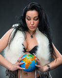Beautiful woman holding a globe Stock Image