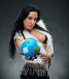 Beautiful woman holding a globe Stock Photography