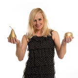 Beautiful woman holding golden fruit in her hands Stock Photos