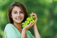 Beautiful woman holding grapes Stock Image