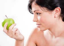 Beautiful woman holding a green apple Royalty Free Stock Image