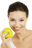 Beautiful woman holding green apple. Stock Image