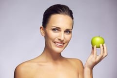 Beautiful woman holding green apple Royalty Free Stock Image