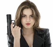 Beautiful woman holding a gun on white background Stock Photos