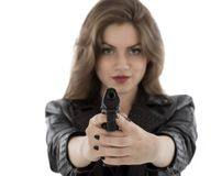 Beautiful woman holding a gun on white background Royalty Free Stock Photography