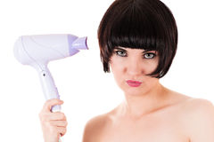 Beautiful woman holding a hairdryer Royalty Free Stock Photo