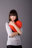 Beautiful woman holding heart Royalty Free Stock Photography