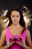 Beautiful woman holding a heart Stock Images