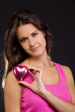 Beautiful woman holding a heart Stock Photo