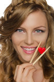 Beautiful woman holding heart with chopsticks Royalty Free Stock Photography