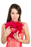 Beautiful woman holding a heart made of feathers Royalty Free Stock Photography