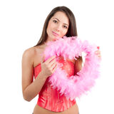 Beautiful woman holding a heart made of feathers Stock Photography