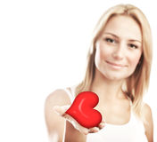Beautiful woman holding heart, selective focus. Beautiful woman holding heart in hand, sensual female portrait isolated on white background, cute girl Royalty Free Stock Image