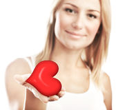 Beautiful woman holding heart, selective focus Stock Photo
