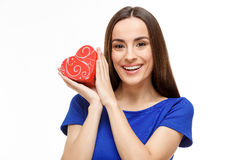 Beautiful woman holding heart shaped gift Royalty Free Stock Photos