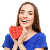 Beautiful woman holding heart shaped gift Royalty Free Stock Images