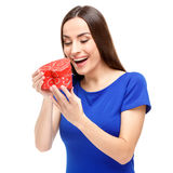 Beautiful woman holding heart shaped gift Stock Images