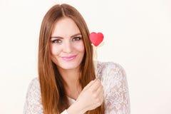 Beautiful woman holding heart shaped hand stick Royalty Free Stock Photos