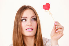 Beautiful woman holding heart shaped hand stick Stock Photos