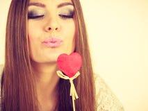 Beautiful woman holding heart shaped hand stick Royalty Free Stock Image